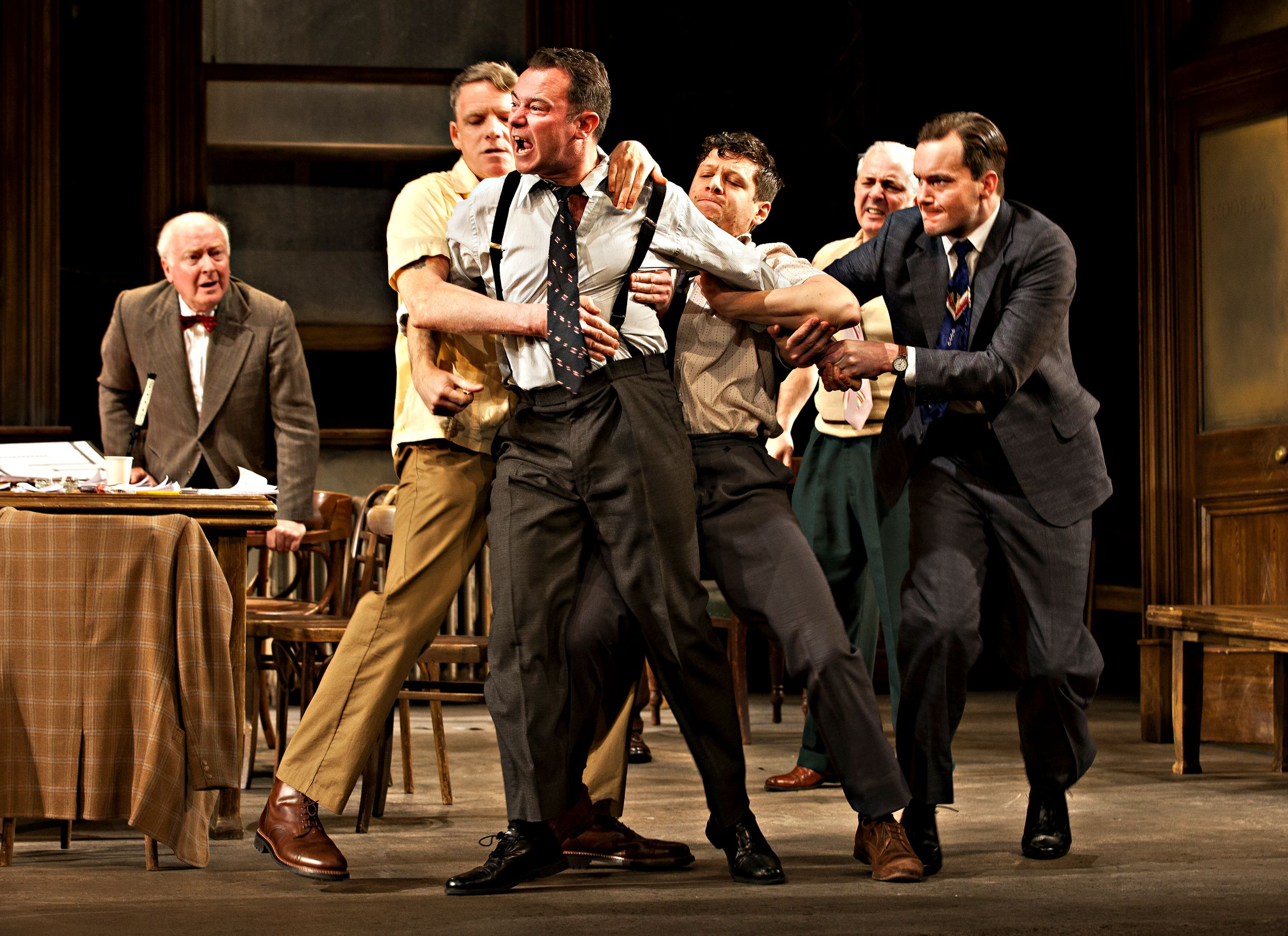 Twelve Angry Men - (centre) Andrew Lancel as Juror 3 and the cast of Twelve Angry Men - Photo credit Pamela Raith Photography- Theatre Royal Bath- Theatre Bath