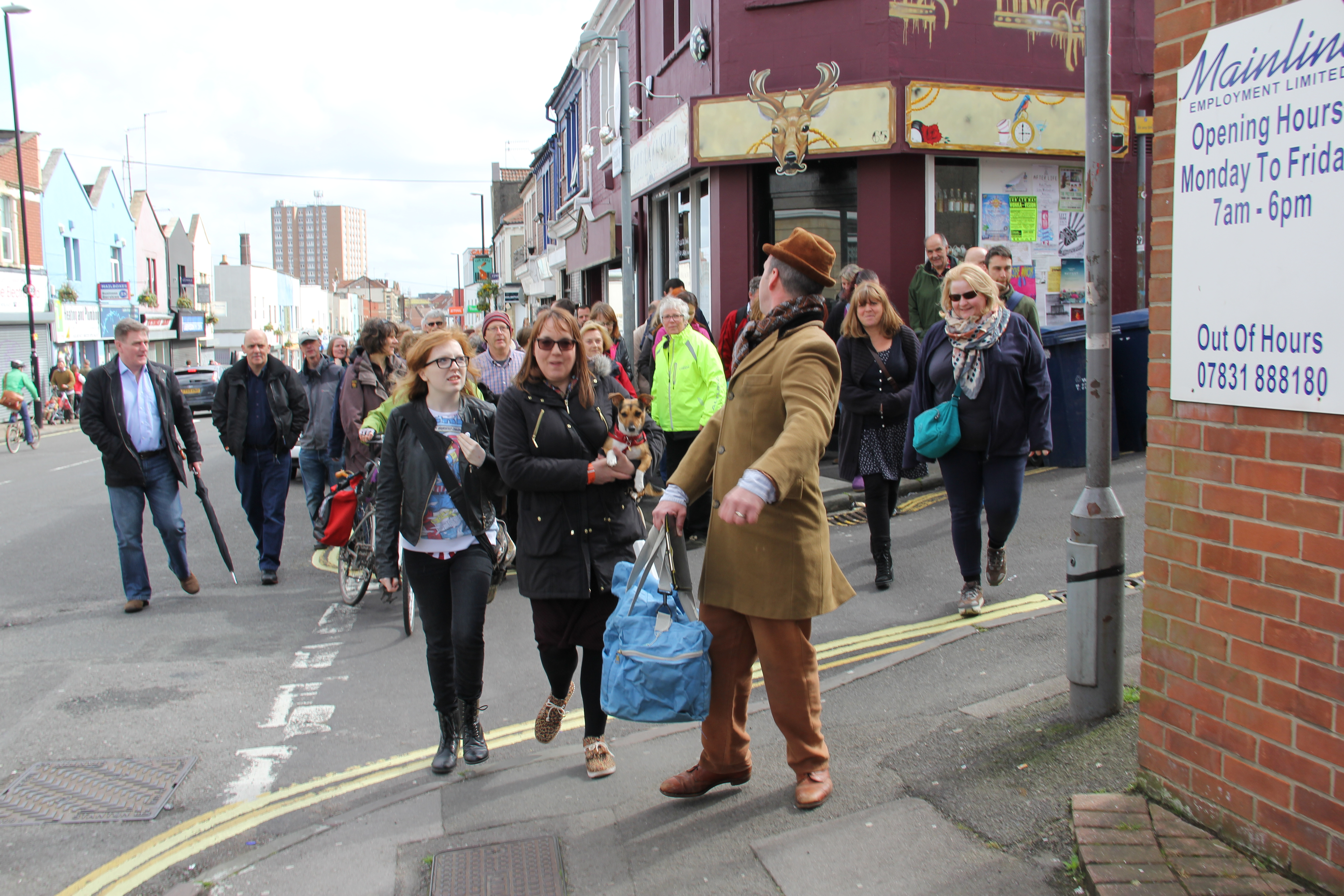 WHY DON'T WE DO IT IN THE ROAD Chris Yapp as Lucky Eric leads the crowd on North Street. Pic Rosie Tomlinson- Theatre Bath