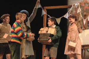 Oliver Loades (as Zach) Alex Taylor-McDowall (as William) with Ensemble in Goodnight Mister Tom - Theatre Royal Bath - Theatre Bath